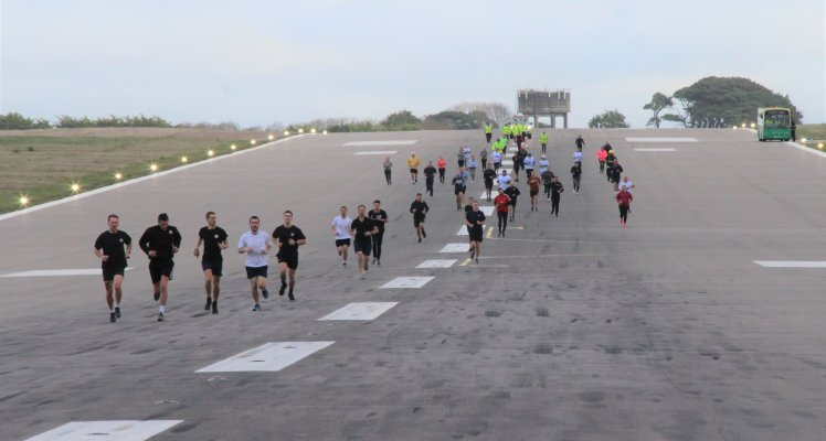 Runners on Guernsey Airport runway