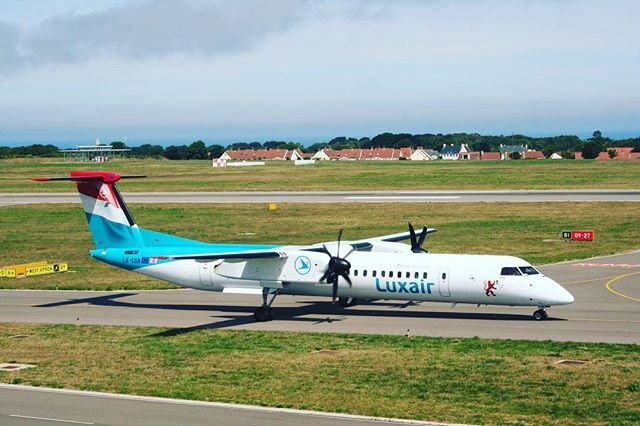 Todays star visitor, and probably a first for #guernseyairport, a colourful Luxair Dash 8 Q400